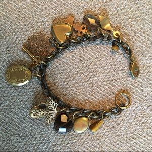 Metal bracelet with assorted charms.